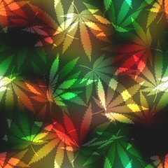 Cannabis leafs on blur rastafarian background.