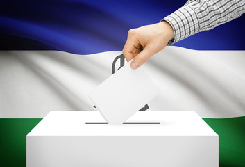 Ballot box with national flag on background - Lesotho