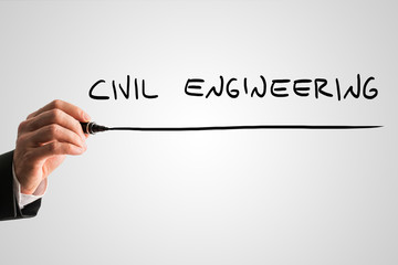 Man writing the words Civil engineering