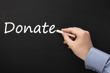 Writing the word Donate on a Blackboard