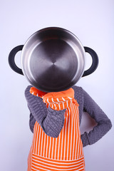 Cooker holding pan on light background