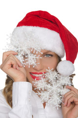 Attractive woman in Santa hat with snowflake