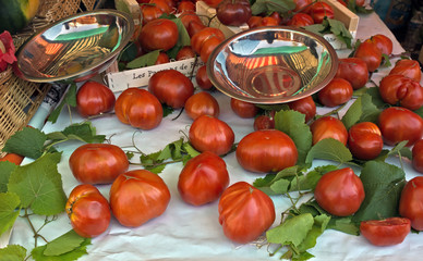 Tomatoes with green leaves