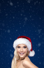 Beautiful woman in Christmas cap, snowflakes background