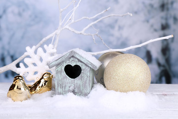 Beautiful Christmas composition with small bird house