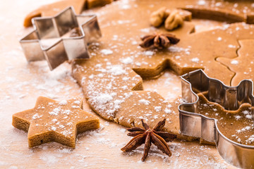 Making Christmas gingerbread cookies. Shallow depth of field.