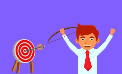 Happy businessman hitting the target