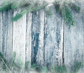 Christmas fir on wooden background