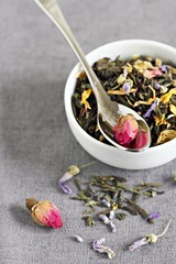 Floral herbal tea on a grey background
