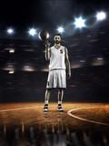 Fototapeta Basketball player is spinning ball around the finger
