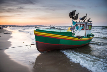 Fishing boat on Baltic Sea beach in Karlikowo in Sopot, Poland