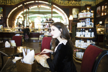 young elegant brunette woman in cafe drinking cofe