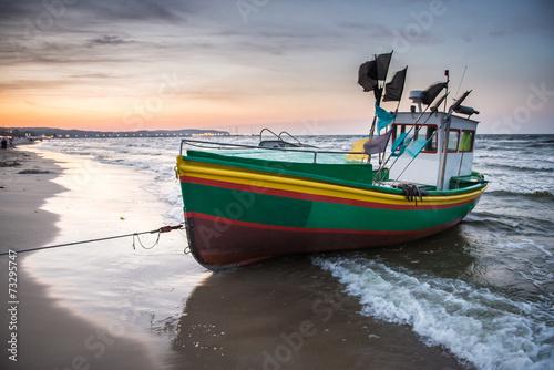 Fototapeta Fishing boat on Baltic Sea beach in Karlikowo in Sopot, Poland