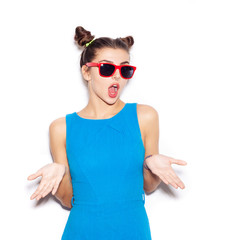 Young Surprised Woman with sunglasses looking at camera