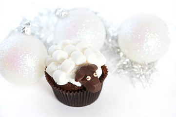 Christmas balls and cake with marshmallow