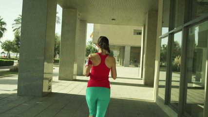 Young woman jogging in the city