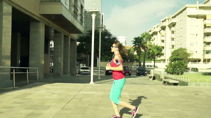 Beautiful woman jogging in the city on a sunny day slow motion,
