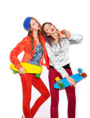 Two young girl friends standing having fun together