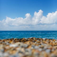 Bright picture of seashore with blue sky and  sea