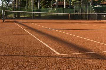 Clay (Dirt) Tennis Court.