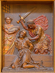 Seville - relief of decapitation of  St. John the Baptist