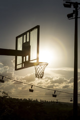 silhouette of a basketball hoop.