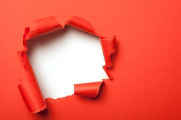 Red paper with hole
