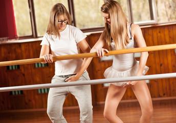 Instructor with ballet dancer