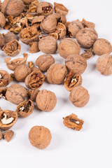 Heap of cracked walnuts.