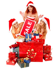 Girl in Santa hat holding Christmas gift box.