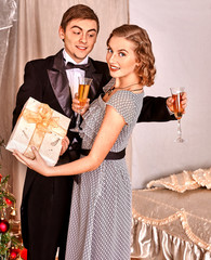 Couple with gift box.