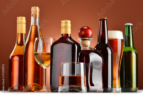 Bottles and glasses of assorted alcoholic beverages - 73298933