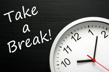 Reminder to Take a Break beside a modern office clock