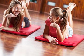 Mixed race teenage girls on training.