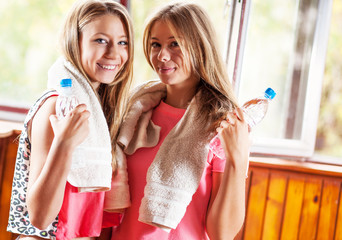 Portrait of sporty girls with bottle of water