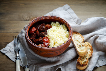 Beef stew with couscous in a ceramic bowl