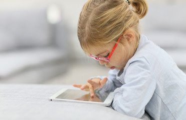 4-year-old girl playing with digital tablet
