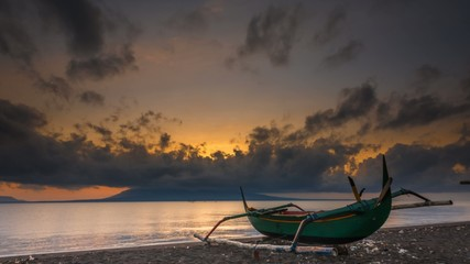 Dramatic Sunrise Time Lapse at beach with Bali Island visible