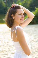 Portrait of the beautiful brown-haired woman outdoor