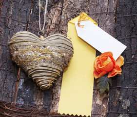 Decorative heart and yellow card