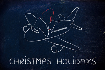 winter and Christmas holiday: plane with santa claus hat