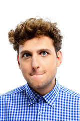 Funny young man with curly hair on white background