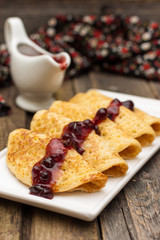 Yeast pancakes with black currant jam