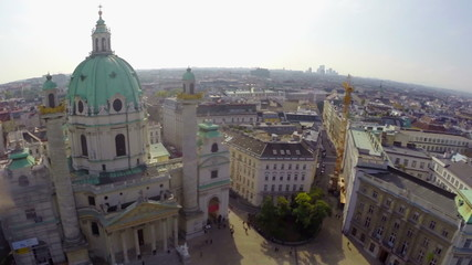Aerial shot of Vienna Karlskirche, Baroque building, tourism air