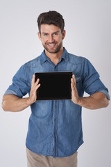 Handsome man showing screen of digital tablet
