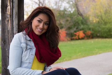 Attractive Latino woman outdoors during autumn