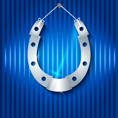 silver-horseshoe-blue-background-vertical-lines