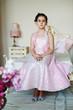 Постер, плакат: Девочка в розовом платье