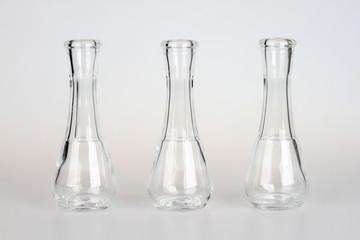 Three little glass bottles