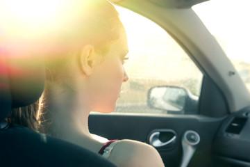 A genuine girl driving a car